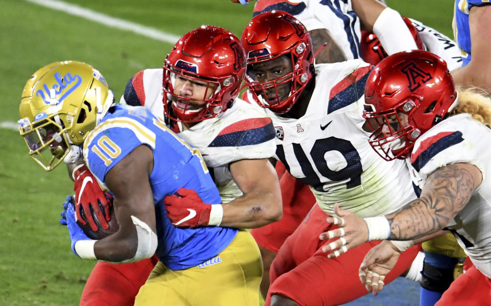 UCLA running back Demetric Felton carries against Arizona during the first half of an NCAA college football game Saturday, Nov. 28, 2020, in Pasadena, Calif. (Keith Birmingham/The Orange County Register via AP)