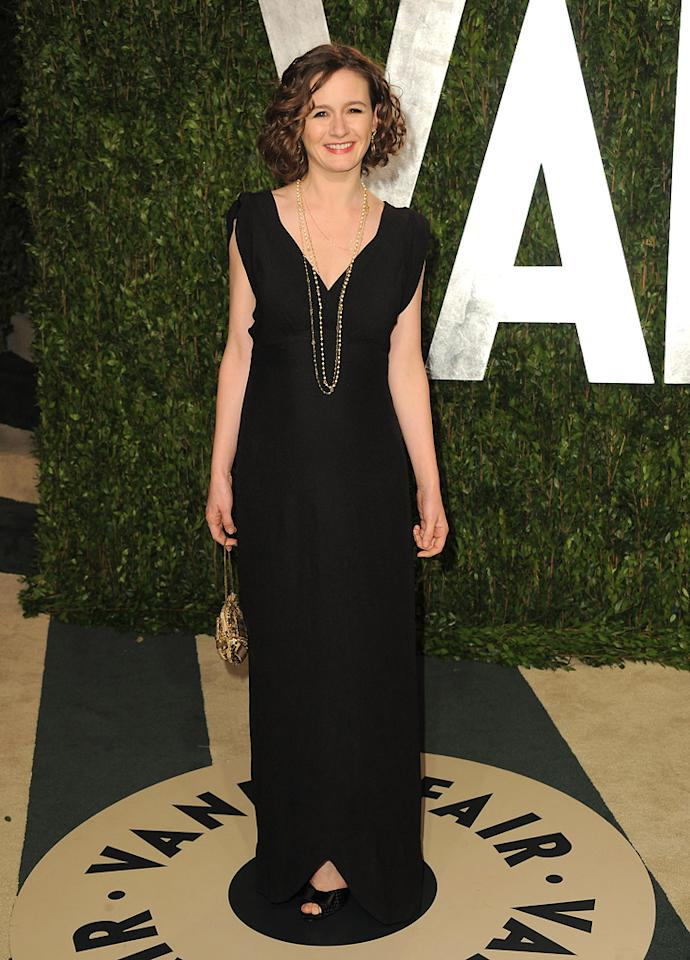 Emily Watson was all smiles upon arriving at the annual VF party in a black frock, curly 'do, and layered necklaces.