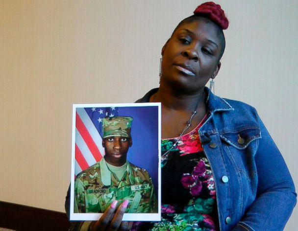 PHOTO: April Pipkins holds a photograph of her deceased son, Emantic 'EJ' Bradford Jr., during an interview in Birmingham, Ala. (Jay Reeves/AP, FILE)