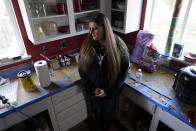 Melissa Mays stands in the kitchen of her home in Flint, Mich., Wednesday, Jan. 13, 2021. Some Flint residents impacted by months of lead-tainted water are looking past expected charges against former Gov. Rick Snyder and others in his administration to healing physical and emotional damages left by the crisis. (AP Photo/Paul Sancya)