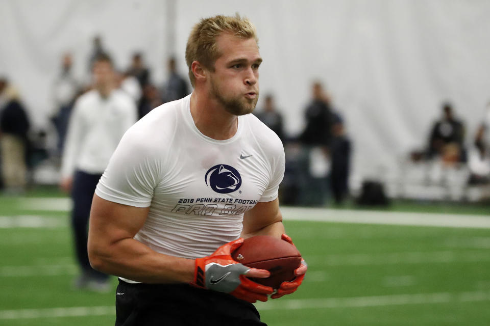 Penn State tight end Mike Gesicki, going through drills during his pro day in March, checked off all the right boxes for the Miami Dolphins. He was the team's second-round draft pick last week. (AP)
