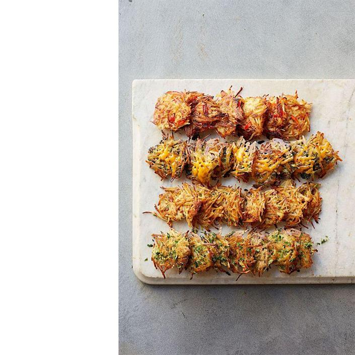 """<p>Kick your hash browns up a notch with these tasty taters. They're made with red pepper, onion, and paprika.</p><p><a href=""""https://www.womansday.com/food-recipes/food-drinks/recipes/a39631/smoky-red-pepper-hash-browns-recipe-ghk0514/"""" rel=""""nofollow noopener"""" target=""""_blank"""" data-ylk=""""slk:Get the Smoky Red Pepper Hash Browns recipe."""" class=""""link rapid-noclick-resp""""><em>Get the Smoky Red Pepper Hash Browns recipe.</em></a></p>"""