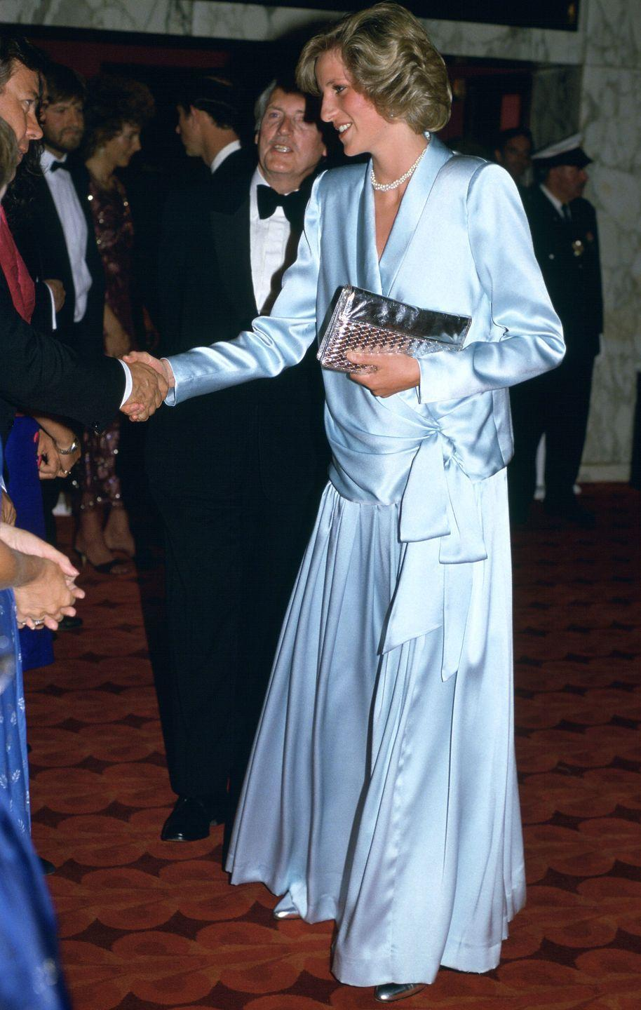 <p>Pregnant with Prince Harry and wearing a baby blue satin Catherine Walker gown at the premiere of Indiana Jones and The Temple of Doom at Leicester Square.</p>