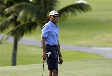 U.S. President Barack Obama smiles as he plays golf at Mid Pacific Country Club in Kailua