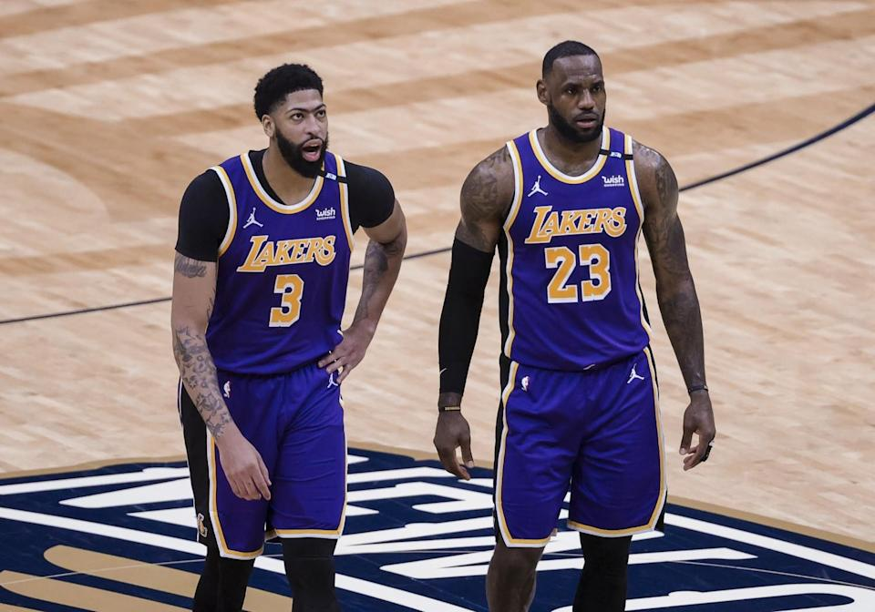 Lakers stars Anthony Davis, left, and LeBron James talk during a timeout against the New Orleans Pelicans.