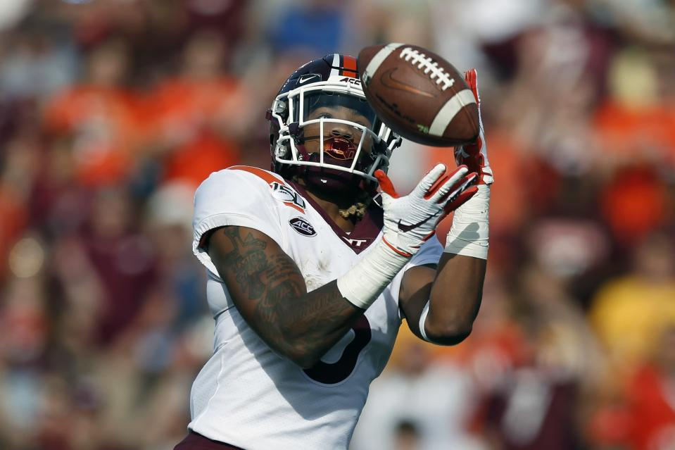 Virginia Tech wide receiver Hezekiah Grimsley makes a touchdown reception during the first half of an NCAA college football game against Boston College in Boston, Saturday, Aug. 31, 2019. (AP Photo/Michael Dwyer)