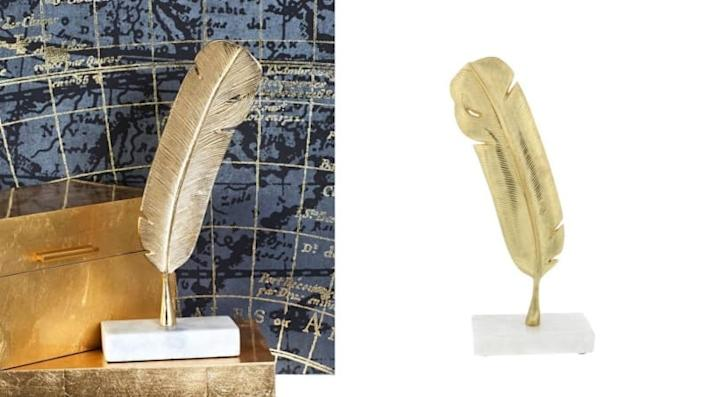 A soft feather in a sturdy brass design provides a texture contrast you never thought you knew you needed.