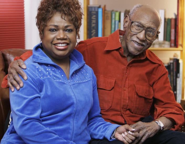 """FILE- In this Jan. 14, 2009, file photo, civil rights leader and political activist Timuel Black and his wife, Zenobia Johnson-Black, sit in their Chicago apartment. Timuel Black, a retired sociology and anthropology professor with City Colleges of Chicago, a former Chicago Public Schools high school history teacher and a pioneer in the independent Black political movement who coined the phrase """"plantation politics,"""" died Wednesday, Oct. 13, 2021, according to his wife. (AP Photo/M. Spencer Green, File)"""