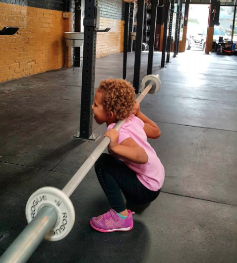 She picked up her first weights when she was 14 months old. Photo: Instagram