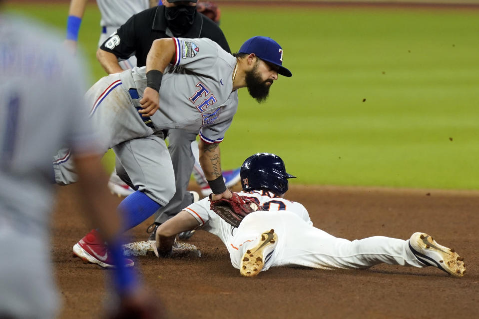 Houston Astros' Kyle Tucker, right, is tagged out by Texas Rangers second baseman Rougned Odor while trying to steal second base during the seventh inning of a baseball game Wednesday, Sept. 16, 2020, in Houston. (AP Photo/David J. Phillip)