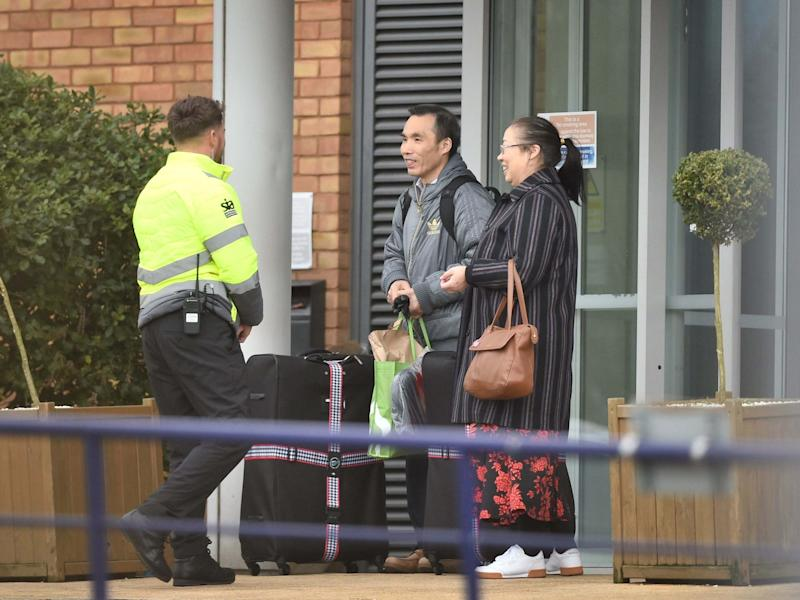 People leave Kents Hill Park Training and Conference Centre in Milton Keynes where Coronavirus evacuees are released from quarantine today and allowed to go home: PA