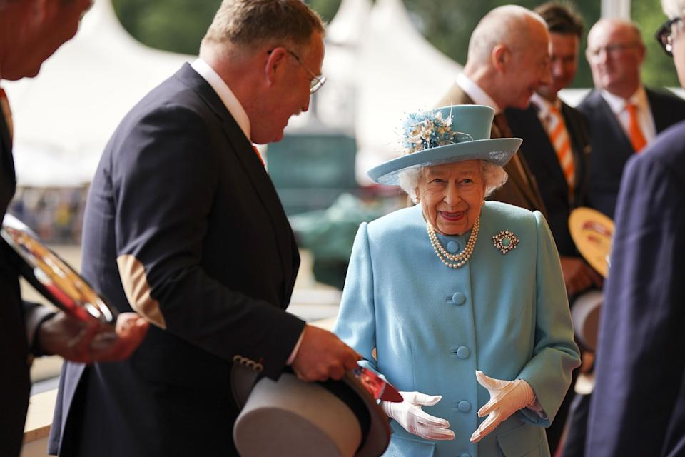Queen Elizabeth II presents the trophy to the Winning team of the Land Rover International Driving Grand Prix at the Royal Windsor Horse Show, Windsor. Picture date: Sunday July 4, 2021. (Photo by Steve Parsons/PA Images via Getty Images)