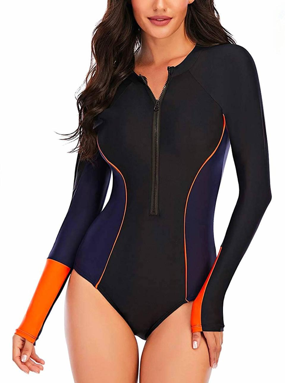 """The pop of orange on this otherwise simple sporty suit is all the intrigue we need. The bottoms are pretty full coverage so you'll be comfortable for whatever summer activity you have lined up. $29, Amazon. <a href=""""https://www.amazon.com/TracyGirl-Protection-Printed-Swimsuit-Swimwear/dp/B08QVZJ4N5/ref="""" rel=""""nofollow noopener"""" target=""""_blank"""" data-ylk=""""slk:Get it now!"""" class=""""link rapid-noclick-resp"""">Get it now!</a>"""