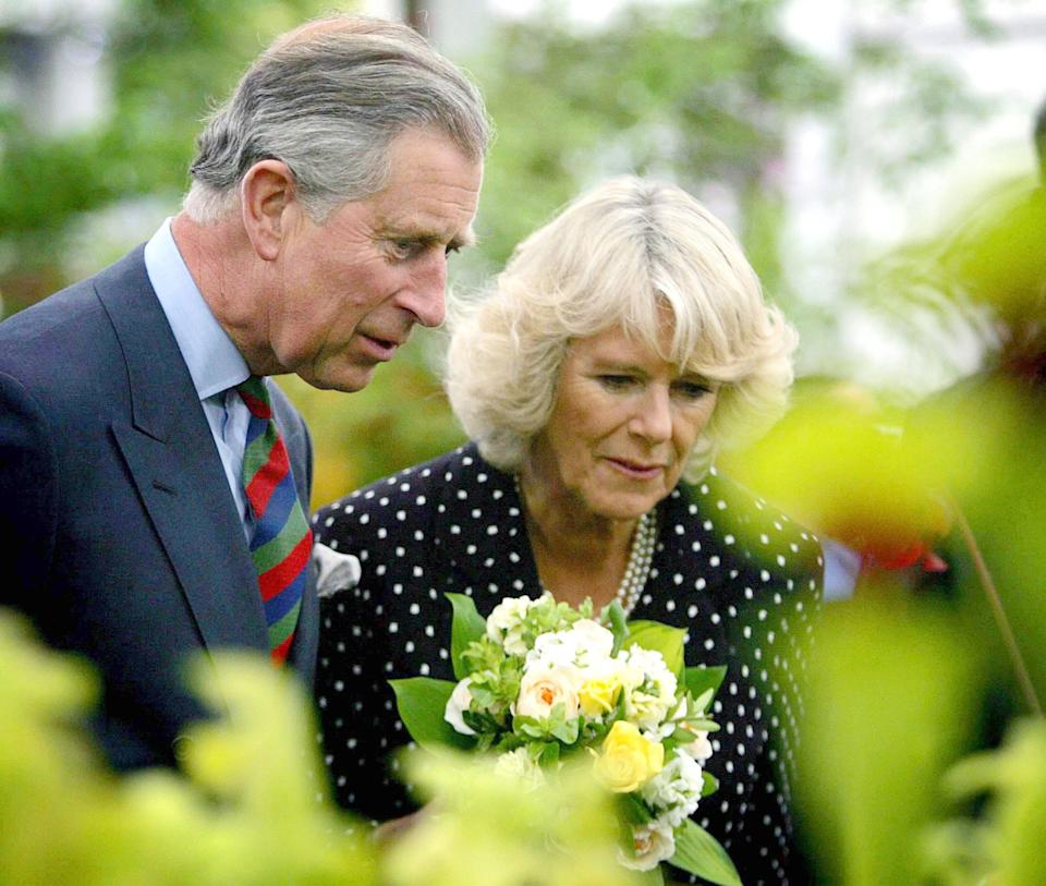 Camilla, Duchess of Cornwall and Prince Charles, Prince of Wales admire flowers on display at Chelsea Flower Show in London (Photo by © Pool Photograph/Corbis/Corbis via Getty Images)