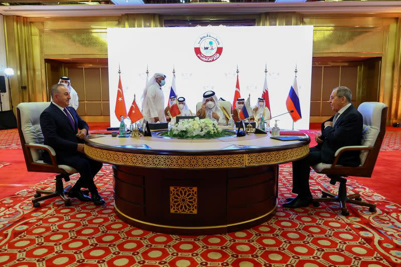 FILE PHOTO: Qatar's Deputy Prime Minister and Minister of Foreign Affairs Mohammed bin Abdulrahman Al Thani meets Russia's Foreign Minister Sergei Lavrov and Turkey's Foreign Minister Mevlut Cavusoglu in Doha