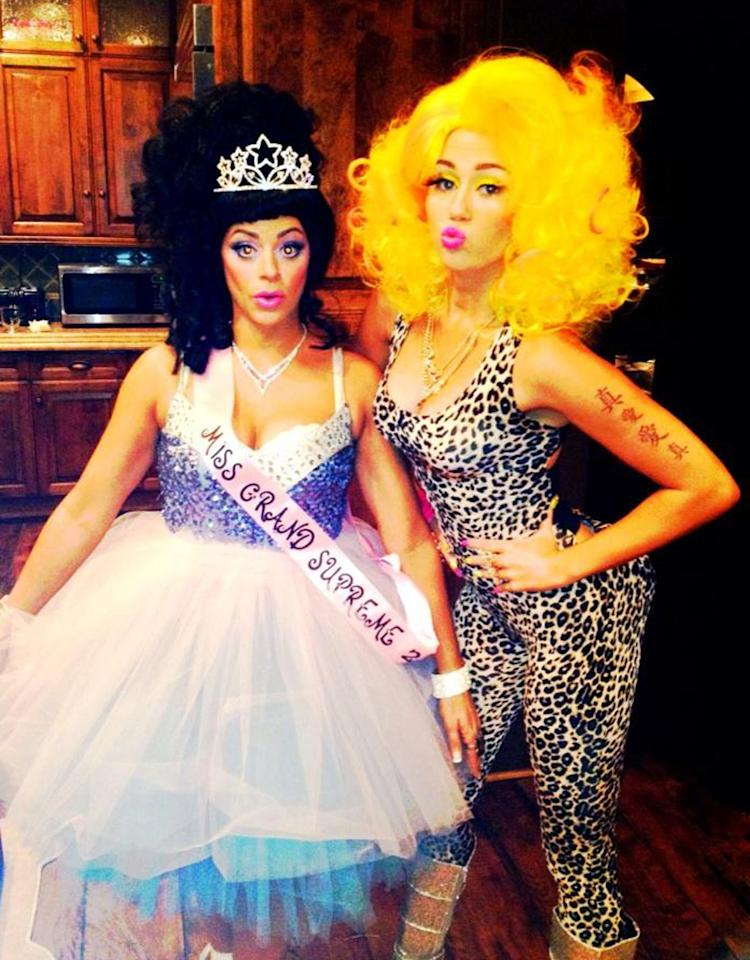 When you're a pop star and you can't come up with a costume idea for Halloween, you can always fall back on being … another pop star. Miley Cyrus, 19, showed up at her bash at the Roosevelt Hotel in Hollywood on Tuesday night dressed as Nicki Minaj. She posted this pic of herself posing with a pal to Twitter Wednesday morning. (10/30/2012)