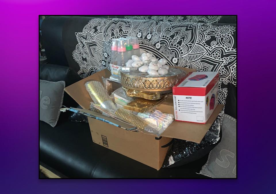 A box of baby shower items sits, untouched, on the author's couch after her event had to be canceled. (Photo courtesy of Kamilah Newton)