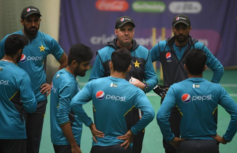 Pakistan's head coach Mickey Arthur speaks with his players during their World Cup campaign