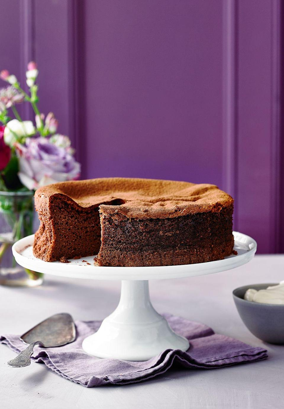 """<p>This light cake is like a set mousse – you can even hear the bubbles pop as you slice it! We recommend using Green & Black's chocolate, as it has the right percentage of cocoa solids.</p><p><strong>Recipe: <a href=""""https://www.goodhousekeeping.com/uk/food/recipes/a26943110/three-ingredient-chocolate-cake/"""" rel=""""nofollow noopener"""" target=""""_blank"""" data-ylk=""""slk:Three-ingredient Chocolate Cake"""" class=""""link rapid-noclick-resp"""">Three-ingredient Chocolate Cake</a></strong></p>"""