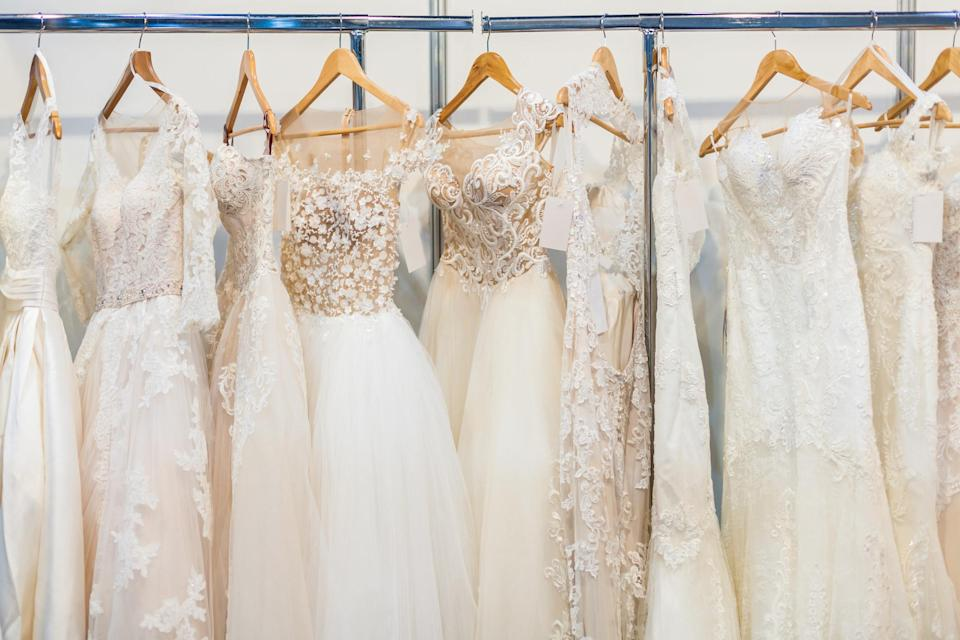 Wedding dresses hanging up in a store