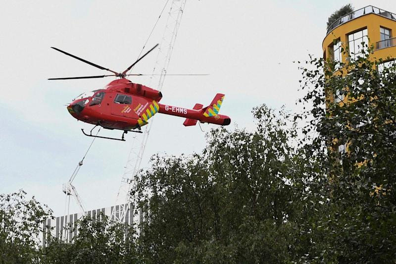 A London Air Ambulance helicopter takes off from outside the Tate Modern gallery. (AFP/Getty Images)