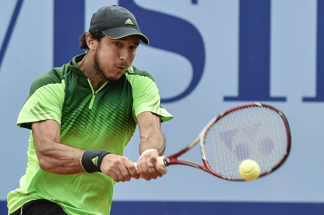 Juan Monaco of Argentina returns a ball to Robin Haase of the Netherlands during the semifinal match at the Swiss Open tennis tournament in Gstaad, Switzerland, Saturday, July 26, 2014. (AP Photo/Keystone,Peter Schneider)