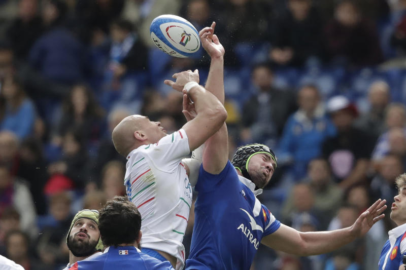 FILE - In this March 16, 2019, file photo, France's Gregory Alldritt, right, goes for the ball with Italy's Sergio Parisse during a Six Nations rugby union international match between Italy and France, at the Rome Olympic stadium. Five years since washing dishes in the countryside, Alldritt is pushing for a World Cup starting spot as Frances No. 8. (AP Photo/Alessandra Tarantino, File)
