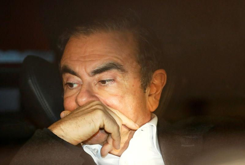 FILE PHOTO: Former Nissan Motor Chairman Carlos Ghosn sits inside a car as he leaves his lawyer's office after being released on bail from Tokyo Detention House, in Tokyo, Japan, March 6, 2019. REUTERS/Issei Kato
