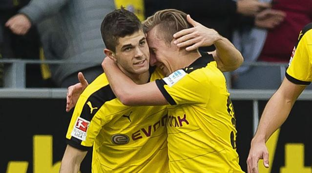 <p>Christian Pulisic of Borussia Dortmund celebrates after scoring the opening goal together with his teammate Felix Passlack during the Bundesliga match against Hamburger SV at Signal Iduna Park on April 17, 2016 in Dortmund, Germany.</p>