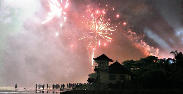 Joyous: Fireworks provide great enjoyment for the people on the beach. (