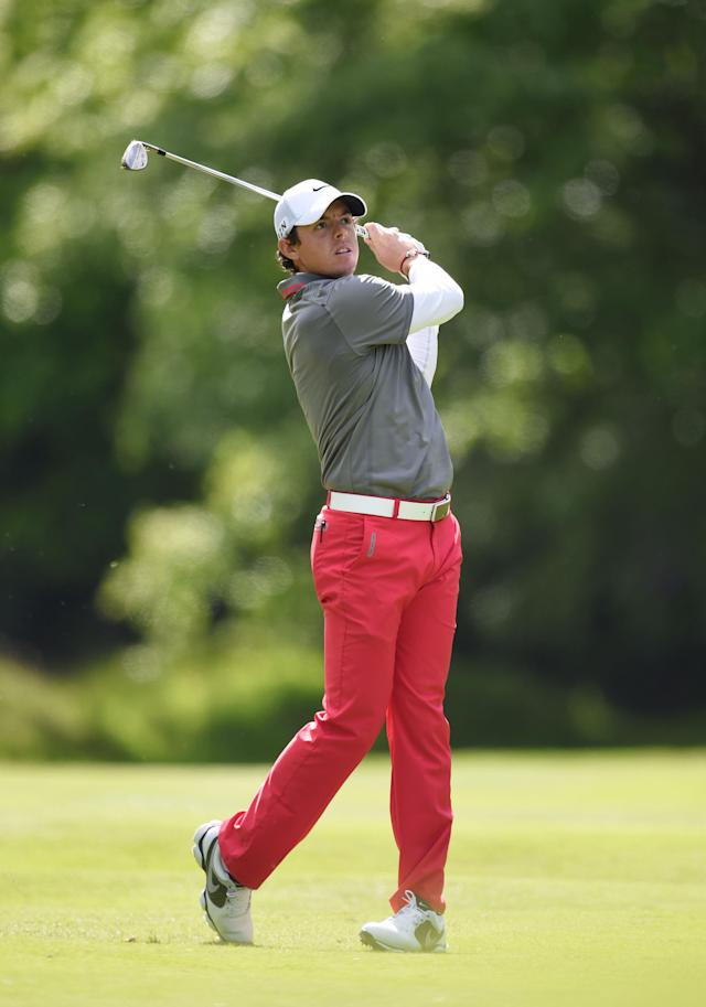 Northern Ireland's Rory Mcilroy plays a shot on the way to winning the BMW PGA Championship at the Wentworth Club, Virginia Water, England, Sunday, May 25, 2014. (AP Photo/ PA, Adam Davy)