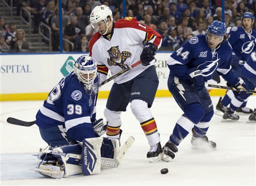 Tampa Bay Lightning goalie Anders Lindback (39), of Sweden, makes a save on a shot by Florida Panthers center Drew Shore (15) after he got past Lightning center Nate Thompson (44) during the first period of an NHL hockey game Saturday, April 27, 2013, in Tampa, Fla. (AP Photo/Chris O'Meara)