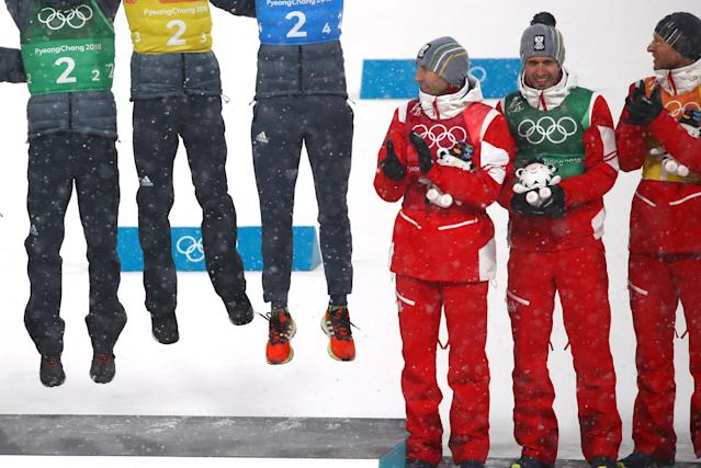 Nordic Combined Events - Pyeongchang 2018 Winter Olympics - Men's Team 4 x 5 km Final - Alpensia Cross-Country Skiing Centre - Pyeongchang, South Korea - February 22, 2018 - The Austrian team applauds as the German team celebrates during the victory ceremony. REUTERS/Carlos Barria