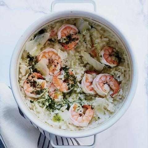 """<p>The secret is baking the rice then adding cheese and pesto in at the last minute.</p><p>Get the <a href=""""http://www.delish.com/uk/cooking/recipes/a30241944/baked-shrimp-risotto/"""" rel=""""nofollow noopener"""" target=""""_blank"""" data-ylk=""""slk:Baked Prawn Risotto"""" class=""""link rapid-noclick-resp"""">Baked Prawn Risotto</a> recipe.</p>"""