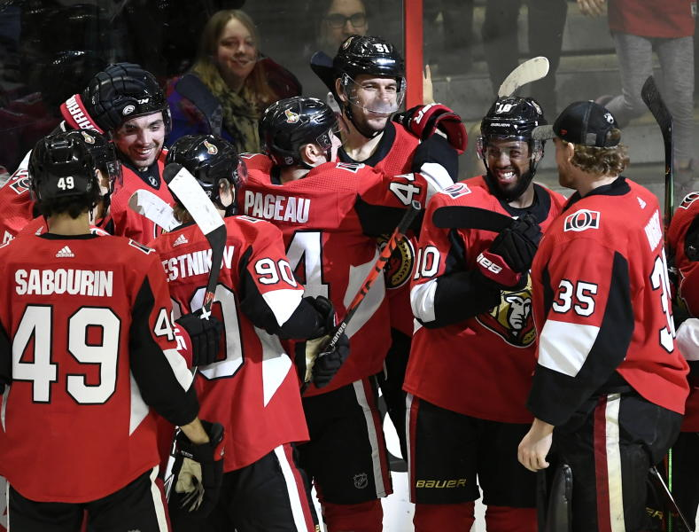 Ottawa Senators center Artem Anisimov, top center, is congratulated for his overtime goal against the Dallas Stars in an NHL hockey game Sunday, Feb. 16, 2020, in Ottawa, Ontario. (Justin Tang/The Canadian Press via AP)