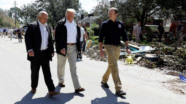 PHOTO: President Donald Trump walks down a street while on a tour of Hurricane Florence recovery efforts in New Bern, N.C., Sept. 19, 2018. (Kevin Lamarque/Reuters)