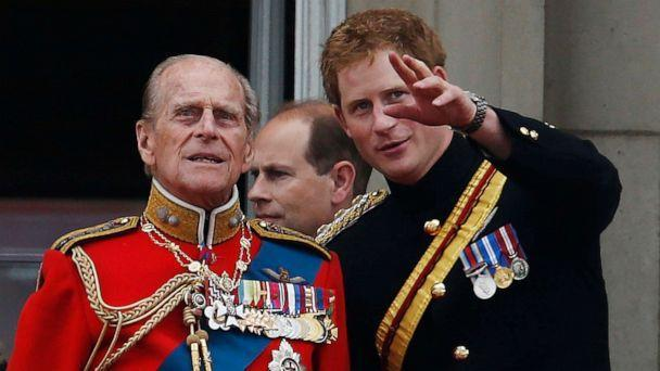 PHOTO: Britain's Prince Harry talks to Prince Philip as members of the Royal family appear on the balcony of Buckingham Palace, during the Trooping The Colour parade, in central London, June 14, 2014. (Lefteris Pitarakis/AP, FILE)