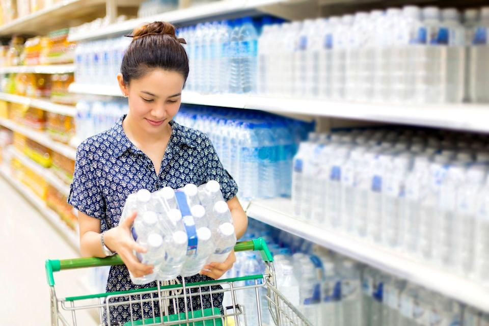 """<p>If your drinking water is unsafe, then you absolutely should buy bottled water. But you can also get by with a <a href=""""https://www.amazon.com/Brita-Large-Everyday-Pitcher-Filter/dp/B01FXN3E74?tag=syn-yahoo-20&ascsubtag=%5Bartid%7C2139.g.33535307%5Bsrc%7Cyahoo-us"""" rel=""""nofollow noopener"""" target=""""_blank"""" data-ylk=""""slk:home-water-filter"""" class=""""link rapid-noclick-resp"""">home-water-filter</a> and a reusable water bottle to save thousands of dollars over time. Bottled water can cost about 1,000 times more than water from a home faucet. Many people buy bottled water for the convenience and portability, but the environmental cost can be steep. A better alternative is to buy <a href=""""https://www.amazon.com/Klean-Kanteen-Classic-Stainless-Insulated/dp/B079986NPW?tag=syn-yahoo-20&ascsubtag=%5Bartid%7C2139.g.33535307%5Bsrc%7Cyahoo-us"""" rel=""""nofollow noopener"""" target=""""_blank"""" data-ylk=""""slk:stainless steel water bottles"""" class=""""link rapid-noclick-resp"""">stainless steel water bottles</a> and store them in the refrigerator for on-the-go use. """"But do whatever you need to do to make sure you're hydrated,"""" says Jaclyn London. </p>"""