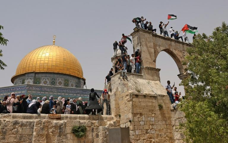 Palestinian Muslim worshippers gather in Jerusalem's Al-Aqsa mosque compound, the third holiest site of Islam, on May 21