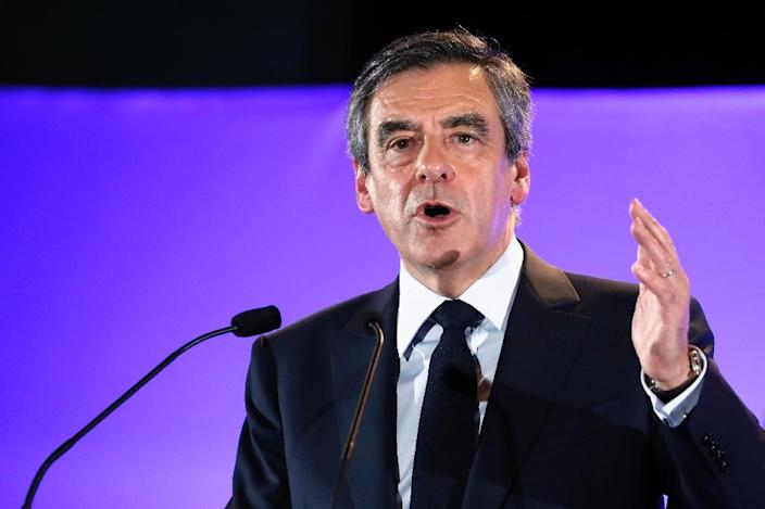 The legal woes of conservative French presidential candidate Francois Fillon have especially played into the hands of far-right candidate Marine Le Pen (AFP Photo/Patrick KOVARIK)