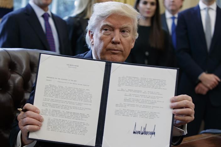 President Donald Trump shows off his signature on an executive order about the Dakota Access pipeline, Tuesday, Jan. 24, 2017, in the Oval Office of the White House in Washington. (Photo: Evan Vucci/AP)