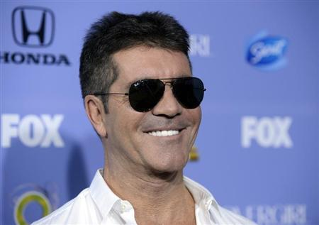"""Judge Simon Cowell attends """"The X Factor"""" season three premiere event in West Hollywood"""