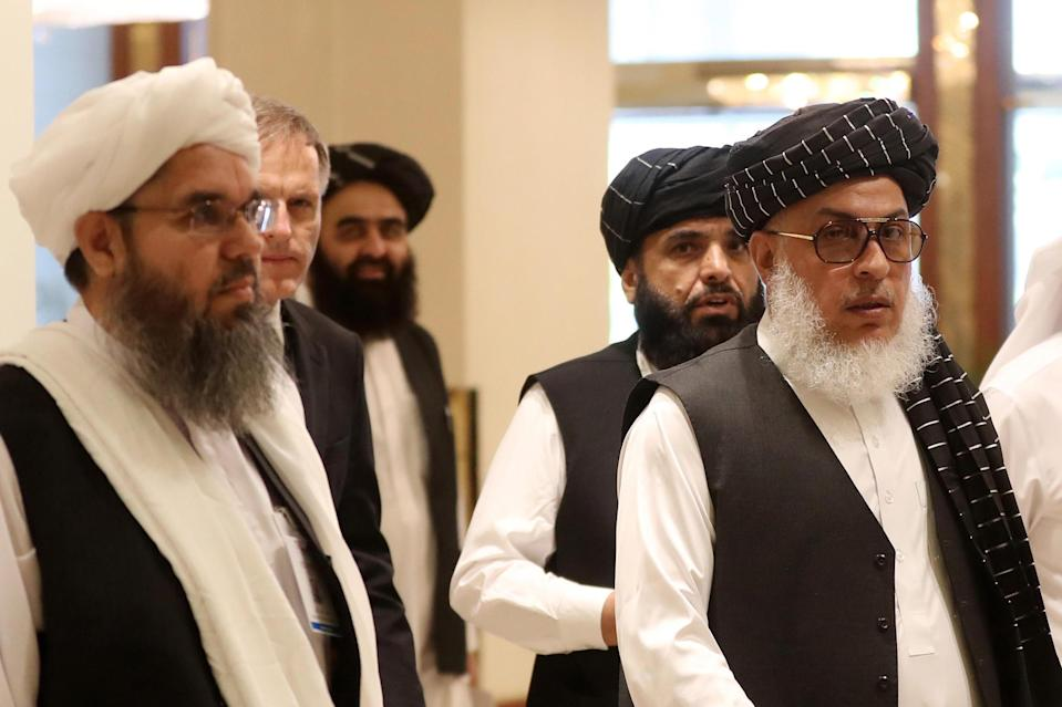 The Taliban's former envoy to Saudi Arabia Shahabuddin Delawar (L) arrives with Taliban negotiator Abbas Stanikzai (R), along with the Taliban's spokesman in Qatar Suhail Shaheen (2nd-R), and the Taliban's former culture and information minister Amir Khan Mutaqi (3rd-L) to attend the Intra-Afghan Dialogue talks in the Qatari capital Doha, July 7, 2019. / Credit: KARIM JAAFAR/AFP/Getty