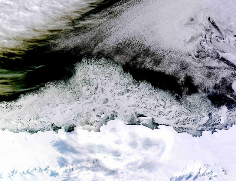 Natural-color sea ice off the coast of East Antarctica�s Princess Astrid Coast is seen in this picture from the Moderate Resolution Imaging Spectroradiometer (MODIS) on NASA�s Terra satellite acquired April 5, 2015 and released April 8, 2015.  White areas close to the continent are sea ice, while white areas in the northeast corner of the image are clouds.  The image was acquired after Antarctic sea ice had passed its annual minimum extent (reached on Feb. 20, 2015), and had resumed expansion toward its maximum extent (usually reached in September).  Picture taken April 5, 2015.  REUTERS/NASA/Jeff Schmaltz, LANCE/EOSDIS Rapid Response/Handout via Reuters THIS IMAGE HAS BEEN SUPPLIED BY A THIRD PARTY. IT IS DISTRIBUTED, EXACTLY AS RECEIVED BY REUTERS, AS A SERVICE TO CLIENTS. FOR EDITORIAL USE ONLY. NOT FOR SALE FOR MARKETING OR ADVERTISING CAMPAIGNS