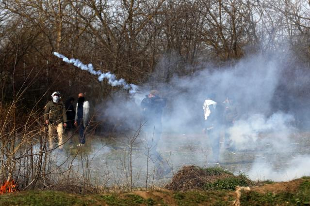 Tear gas is being used during clashes at the Turkish-Greek border near the Pazarkule border gate in Edirne, Turkey to stop migrants from entering Greece. (AP)