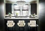 "<p>Designer <a href=""https://susanferrierinteriors.com/"" rel=""nofollow noopener"" target=""_blank"" data-ylk=""slk:Susan Ferrier"" class=""link rapid-noclick-resp"">Susan Ferrier</a>'s dreamy dark and moody kitchen is given a glam upgrade with a chandelier inspired by antique armillary. Its central location is the perfect place to refract light and make the room feel more open and airy than it actually is. </p>"