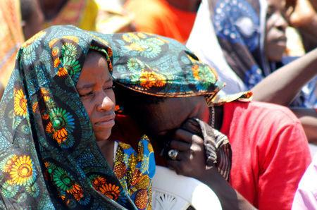 Relatives mourn as they attend the burial of dead passengers retrieved after the MV Nyerere ferry overturned off the shores of Ukara Island in Lake Victoria