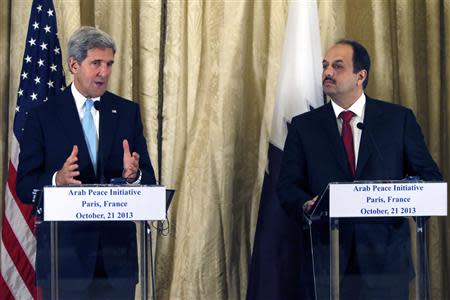 U.S. Secretary of State Kerry and Qatar's Foreign Minister al-Attiyah attend a news conference at the U.S. Ambassador residence in Paris