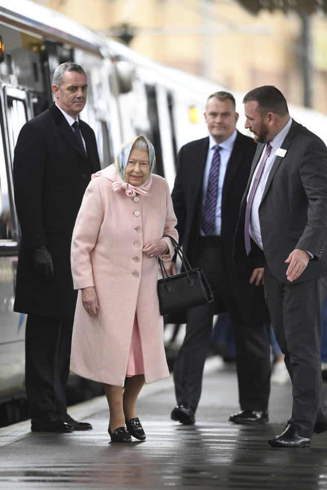 Britain's Queen Elizabeth arrives at King's Lynn railway station in Norfolk on Friday afternoon (AP)