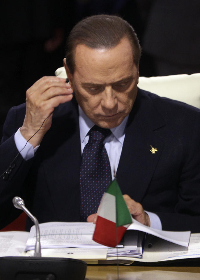 Italian Prime Minister Silvio Berlusconi attends a G20 meeting in Cannes, Thursday, Nov.3, 2011. U.S. President Barack Obama joined other world leaders in the south of France Thursday for a G20 meeting that is expected to focus on the Greek debt crisis and broader European financial troubles. (AP Photo/Michel Euler)